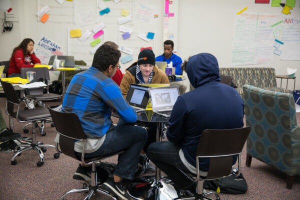 Students work together at Quest Forward Academy Omaha