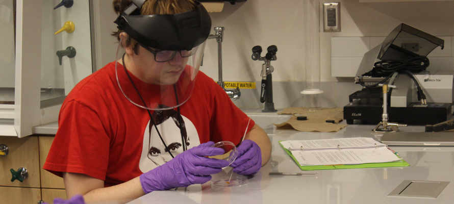 A student at Quest Forward Academy Omaha works in the lab.