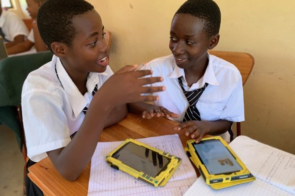Two students collaborate at Mtakuja Secondary School in Tanzania.