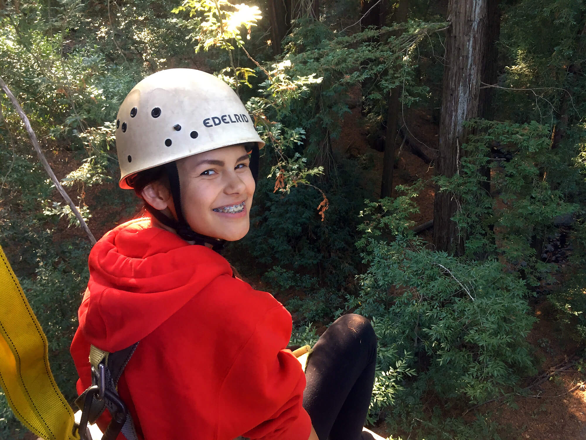 A Quest Forward Academy Santa Rosa student at the top of a ropes course.