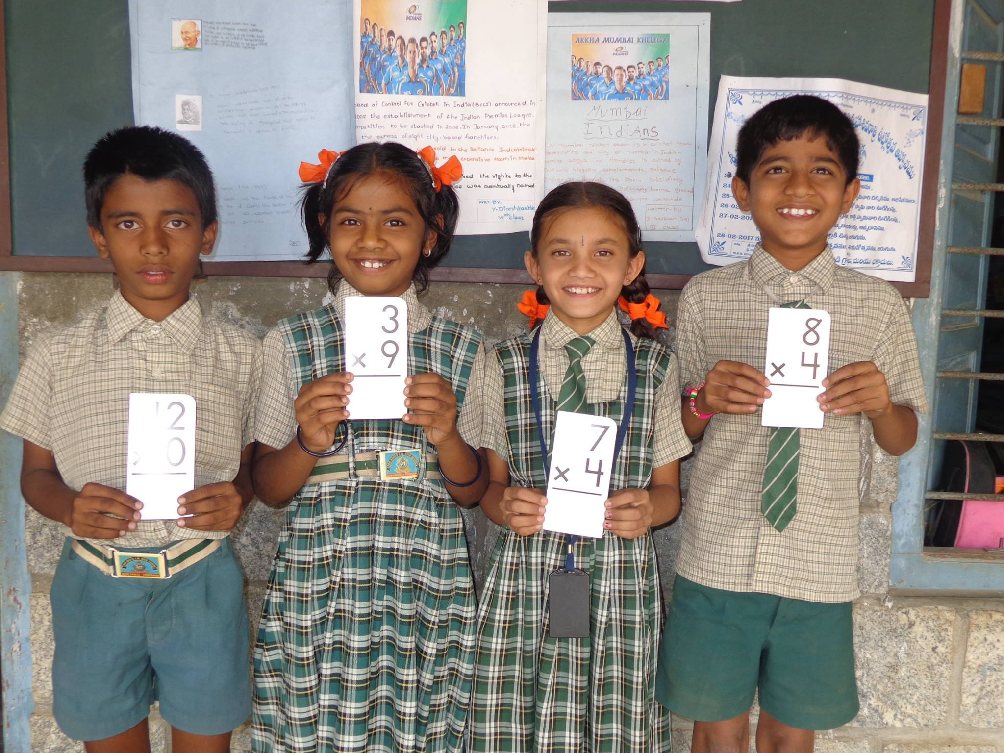 Primary Program students in India hold math materials provided by Opportunity Education, founded by Joe Ricketts