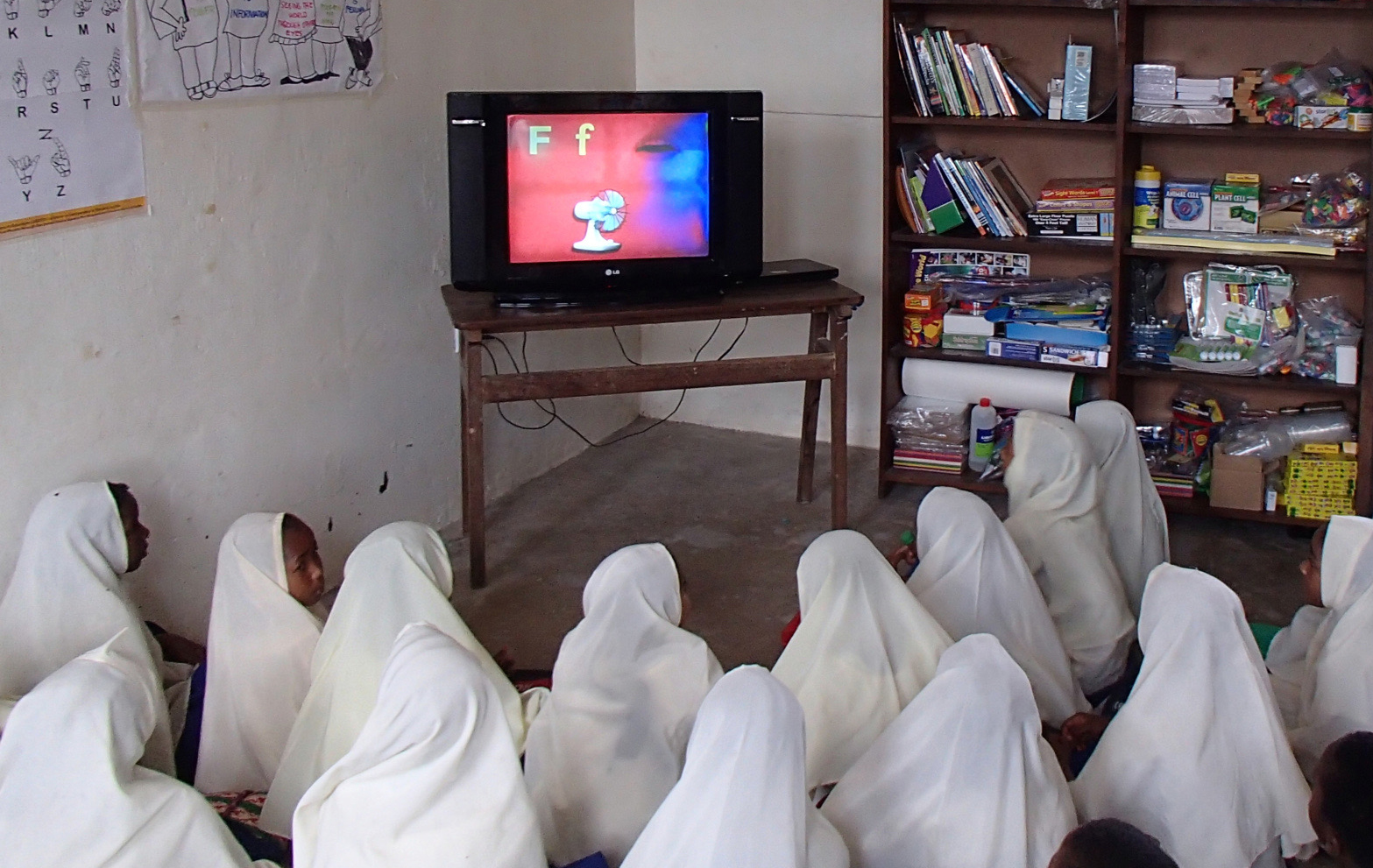 Children view one of many Opportunity Education's primary school videos.