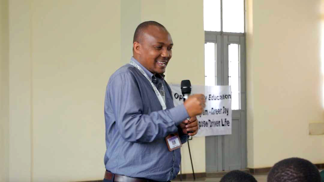 Christian Bwaya of Mwenge University speaks at the first annual Career Day for Quest Forward students in Tanzania.