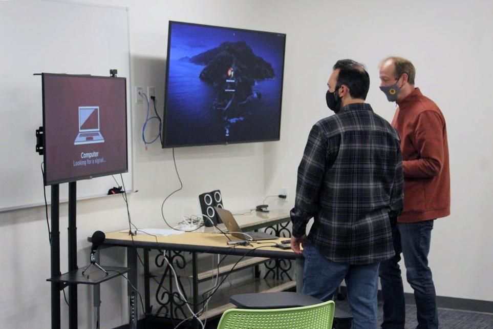 Quest Forward Academy Santa Rosa mentors set up monitors for seamless learning.